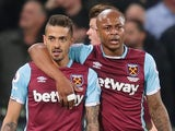 West Ham United's Andre Ayew congratulates Manuel Lanzini for scoring against Tottenham Hotspur on May 5, 2017