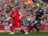 James Milner and Dusan Tadic in action during the Premier League game between Liverpool and Southampton on May 7, 2017
