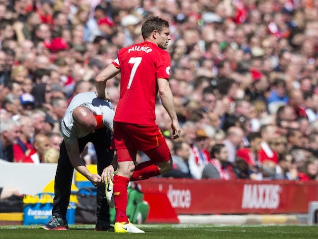 James Milner has his studs tweaked during the Premier League game between Liverpool and Southampton on May 7, 2017