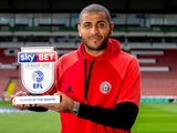 Sheffield United striker Leon Clarke poses with his League One player of the month award for April 2017