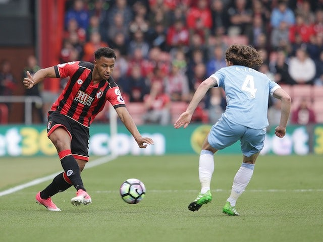 Lys Mousset and Joe Allen in action during the Premier League game between Bournemouth and Stoke City on May 6, 2017