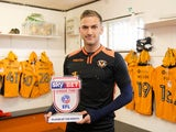 Newport County defender Mickey Demetriou poses with his League Two player of the month award for April 2017