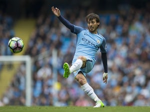 Guardiola urges Silva to sign new contract