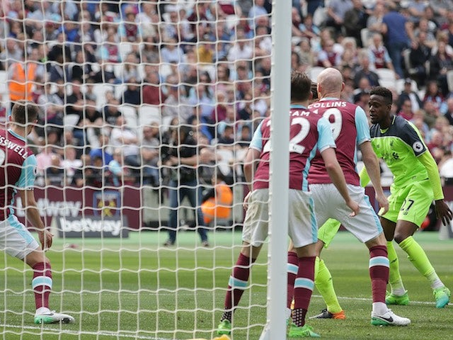 Divock Origi completes the scoring during the Premier League game between West Ham United and Liverpool on May 14, 2017