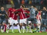Manchester United's Eric Bailly and Celta Vigo's Facundo Roncaglia come to blows before being sent off in the Europa League semi-final on May 11, 2017