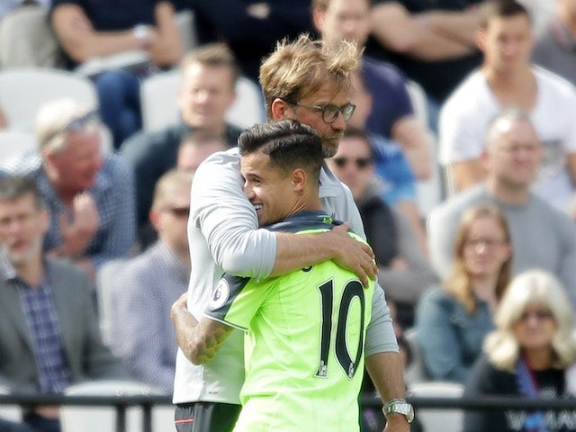 Jurgen Klopp celebrates with Philippe Coutinho after the Premier League game between West Ham United and Liverpool on May 14, 2017