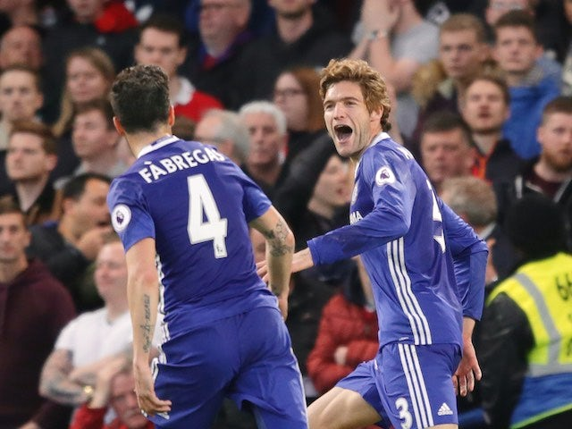 Marcos Alonso celebrates scoring his side's second during the Premier League game between Chelsea and Middlesbrough on May 8, 2017