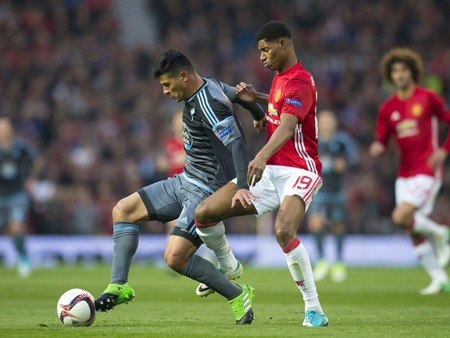 Marcus Rashford and Facundo Roncaglia during the Europa League semi-final between Manchester United and Celta Vigo on May 11, 2017