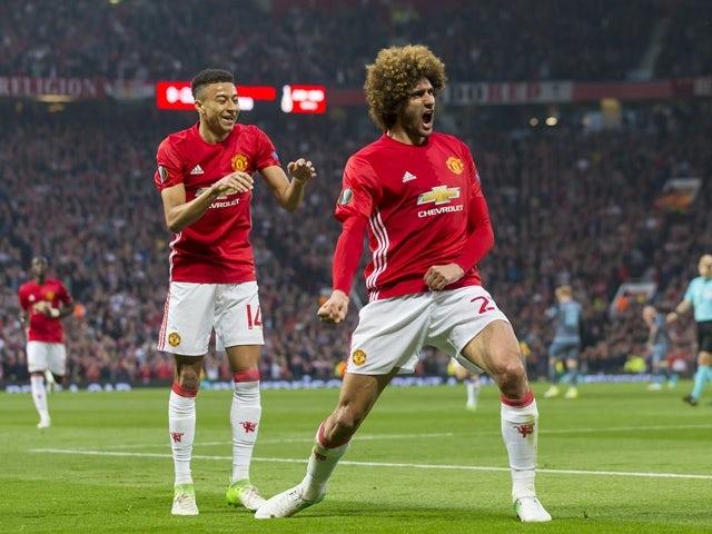 Manchester United midfielder Marouane Fellaini celebrates scoring in the Europa League match against Celta Vigo on May 11, 2017