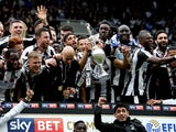 Newcastle United players celebrate being crowned champions of the Championship on May 7, 2017