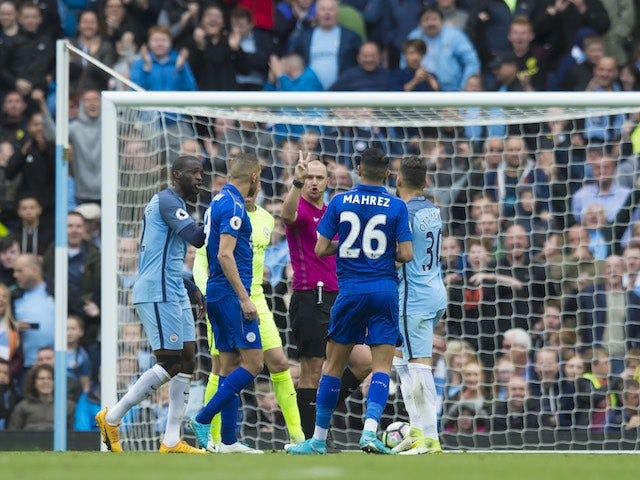 Riyad Mahrez has a penalty disallowed during the Premier League game between Manchester City and Leicester City on May 13, 2017