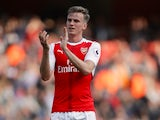 Rob Holding applauds during the Premier League game between Arsenal and Manchester United on May 7, 2017