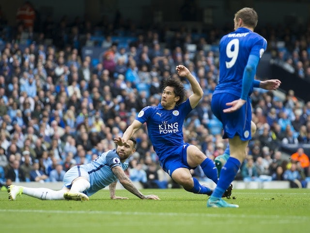 Shinji Okazaki scores during the Premier League game between Manchester City and Leicester City on May 13, 2017
