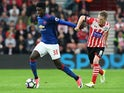 Manchester United's Axel Tuanzebe holds off Southampton's Steven Davis on May 17, 2017