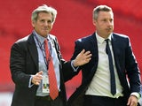 Millwall chairman John Berylson and manager Neil Harris celebrate at the League One playoff final victory over Bradford City on May 20, 2017