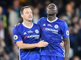 Chelsea's John Terry and Kurt Zouma celebrate after the 4-3 victory over Watford on May 15, 2017