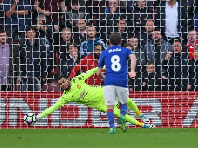 Manchester United's Sergio Romero saves a penalty against Southampton on May 17, 2017