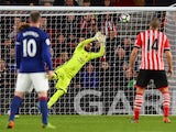 Manchester United's Sergio Romero saves from Southampton's James Ward-Prowse during the Premier League match on May 17, 2017