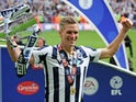 Millwall's Steve Morison holds the trophy after their League One playoff final victory over Bradford City on May 20, 2017