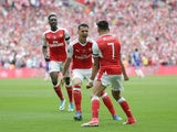 Alexis Sanchez is congratulated by Granit Xhaka after scoring during the FA Cup final between Arsenal and Chelsea on May 27, 2017