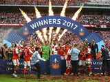Arsenal celebrate with the trophy after winning the FA Cup final against Chelsea on May 27, 2017