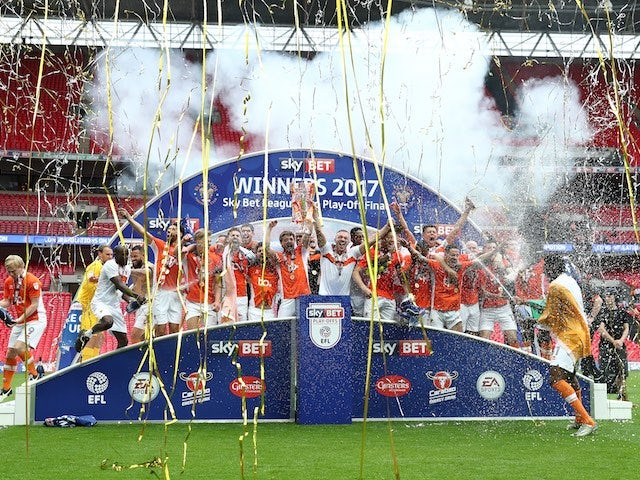 Blackpool players celebrate promotion to League One on May 28, 2017