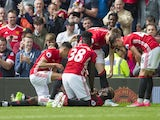 Paul Pogba celebrates with teammates after scoring during the Premier League game between Manchester United and Crystal Palace on May 21, 2017
