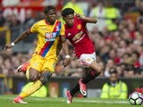 Wilfried Zaha and Demetri Mitchell in action during the Premier League game between Manchester United and Crystal Palace on May 21, 2017