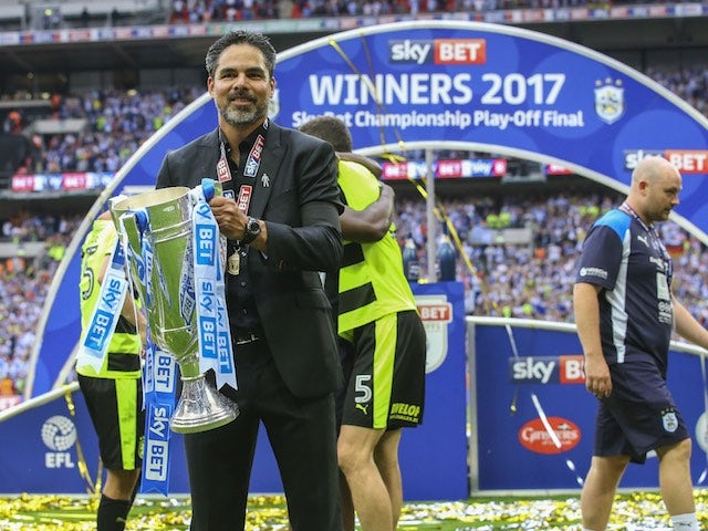David Wagner poses with the trophy after Huddersfield Town win promotion to the Premier League on May 29, 2017