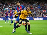 Sandro Ramirez and Gerard Pique during the La Liga match between Malaga and Barcelona on November 19, 2016