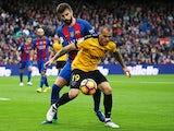 Sandro Ramirez and Gerard Pique during the La Liga match between Malaga and Barcelona on November 19, 2016