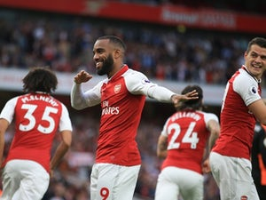 Alexandre Lacazette celebrates scoring the opener during the Premier League game between Arsenal and Leicester City on August 11, 2017