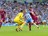 Ederson, Jamie Murphy and Kyle Walker in action during the Premier League game between Brighton & Hove Albion and Manchester City on August 12, 2017