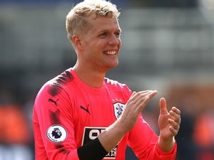 Terriers keeper Jonas Lossl celebrates after the Premier League game between Crystal Palace and Huddersfield Town on August 12, 2017