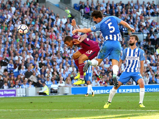 Lewis Dunk scores an own goal during the Premier League game between Brighton & Hove Albion and Manchester City on August 12, 2017