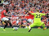Romelu Lukaku scores the opener during the Premier League game between Manchester United and West Ham United on August 13, 2017
