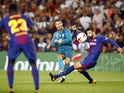 Cristiano Ronaldo scores past Gerard Pique during the Supercopa de Espana first-leg match between Barcelona and Real Madrid on August 13, 2017