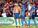Cristiano Ronaldo disrobes during the Supercopa de Espana first-leg match between Barcelona and Real Madrid on August 13, 2017