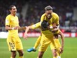 Neymar mounts Edinson Cavani during the Ligue 1 match between Guingamp and Paris Saint-Germain on August 13, 2017