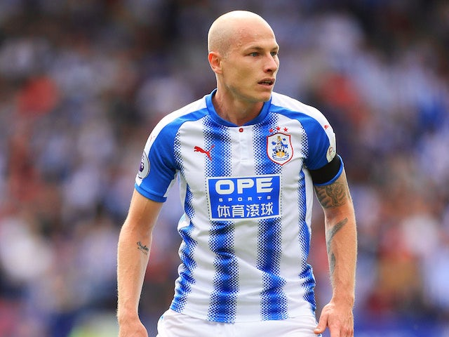 Aaron Mooy in action during the Premier League game between Huddersfield Town and Newcastle United on August 20, 2017