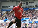 Anthony Martial celebrates the fourth during the Premier League game between Swansea City and Manchester United on August 19, 2017