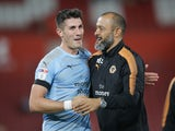 Wolves skipper Danny Batth celebrates with manager Nuno Espirito Santo during the EFL Cup game between Southampton and Wolverhampton Wanderers on August 23, 2017