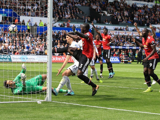 Eric Bailly scores the opener during the Premier League game between Swansea City and Manchester United on August 19, 2017
