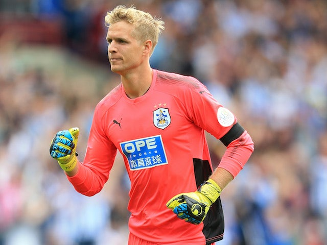 Jonas Lossl in action during the Premier League game between Huddersfield Town and Newcastle United on August 20, 2017