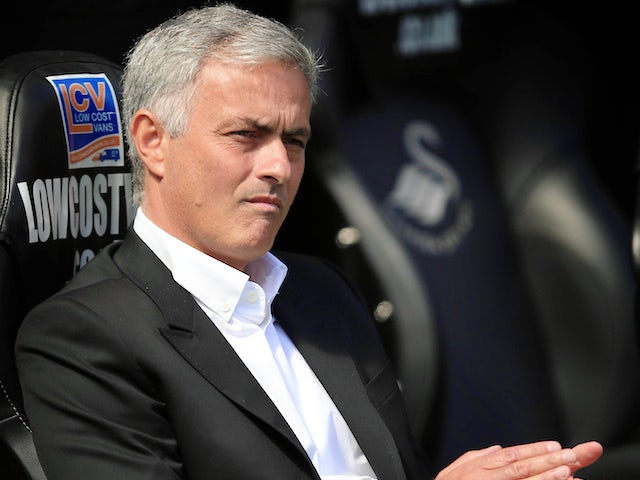 Jose Mourinho watches on during the Premier League game between Swansea City and Manchester United on August 19, 2017