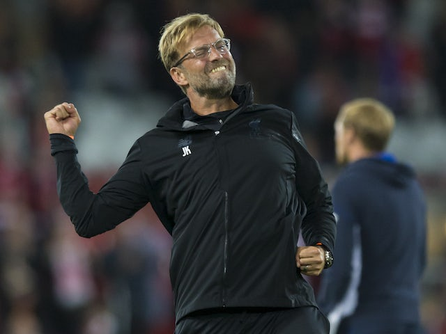 Jurgen Klopp celebrates during the Champions League playoff between Liverpool and Hoffenheim on August 23, 2017