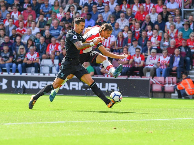 Manolo Gabbiadini opens the scoring during the Premier League game between Southampton and West Ham United on August 19, 2017