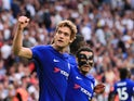 Marcos Alonso celebrates during the Premier League game between Tottenham Hotspur and Chelsea on August 20, 2017