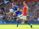 Matty James and Henrikh Mkhitaryan in action during the Premier League game between Manchester United and Leicester City on August 26, 2017