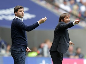 Mauricio Pochettino and Antonio Conte give instructions during the Premier League game between Tottenham Hotspur and Chelsea on August 20, 2017